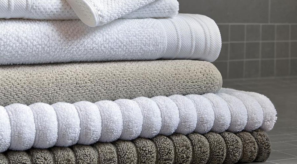Four white towels stacked together