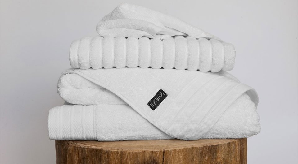 Three white towels stacked together