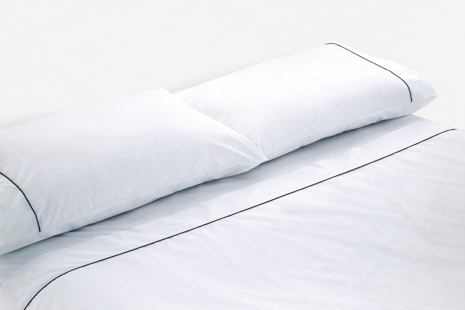cotton percale sheeting in white with black piping