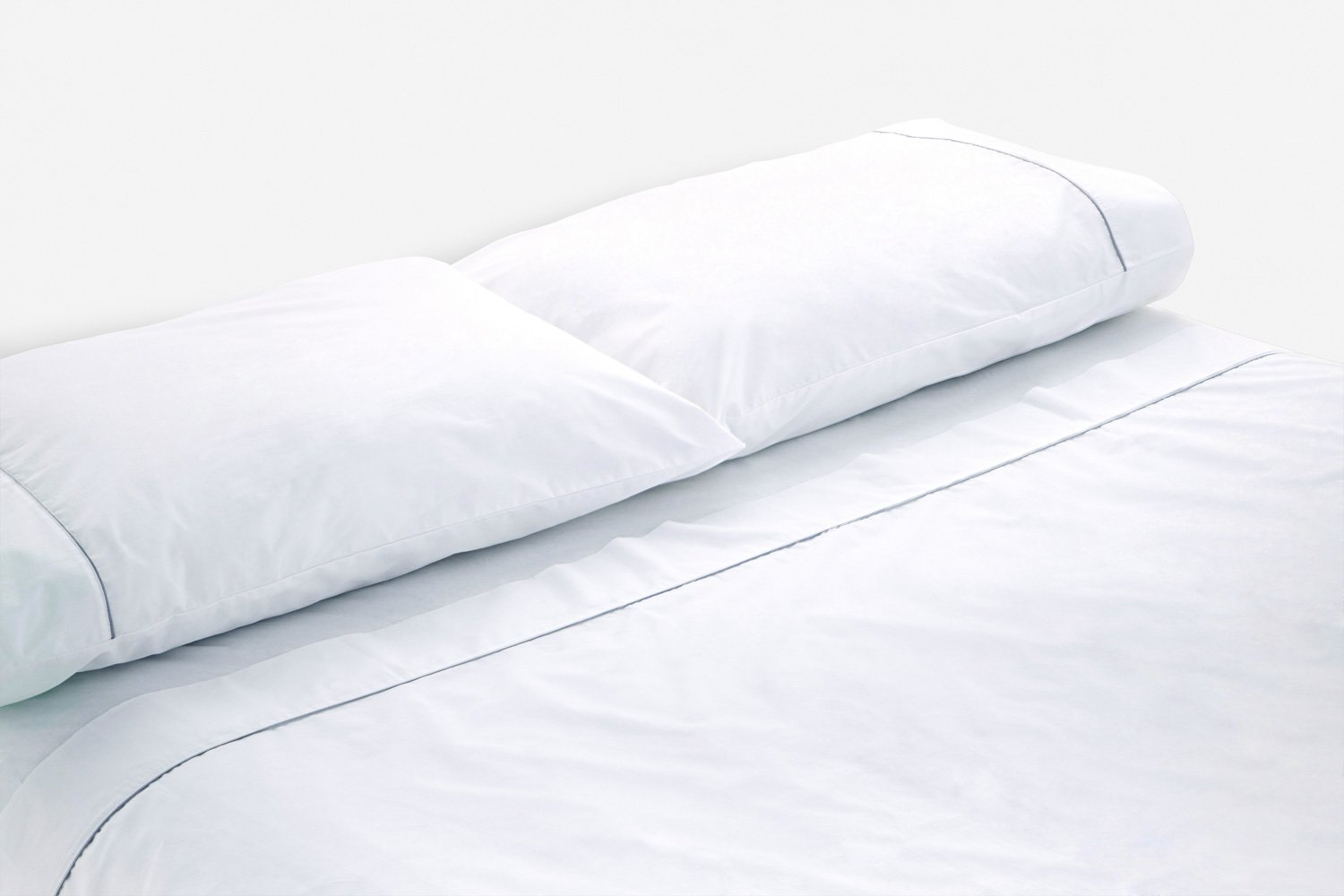 cotton percale sheeting in white with silver piping