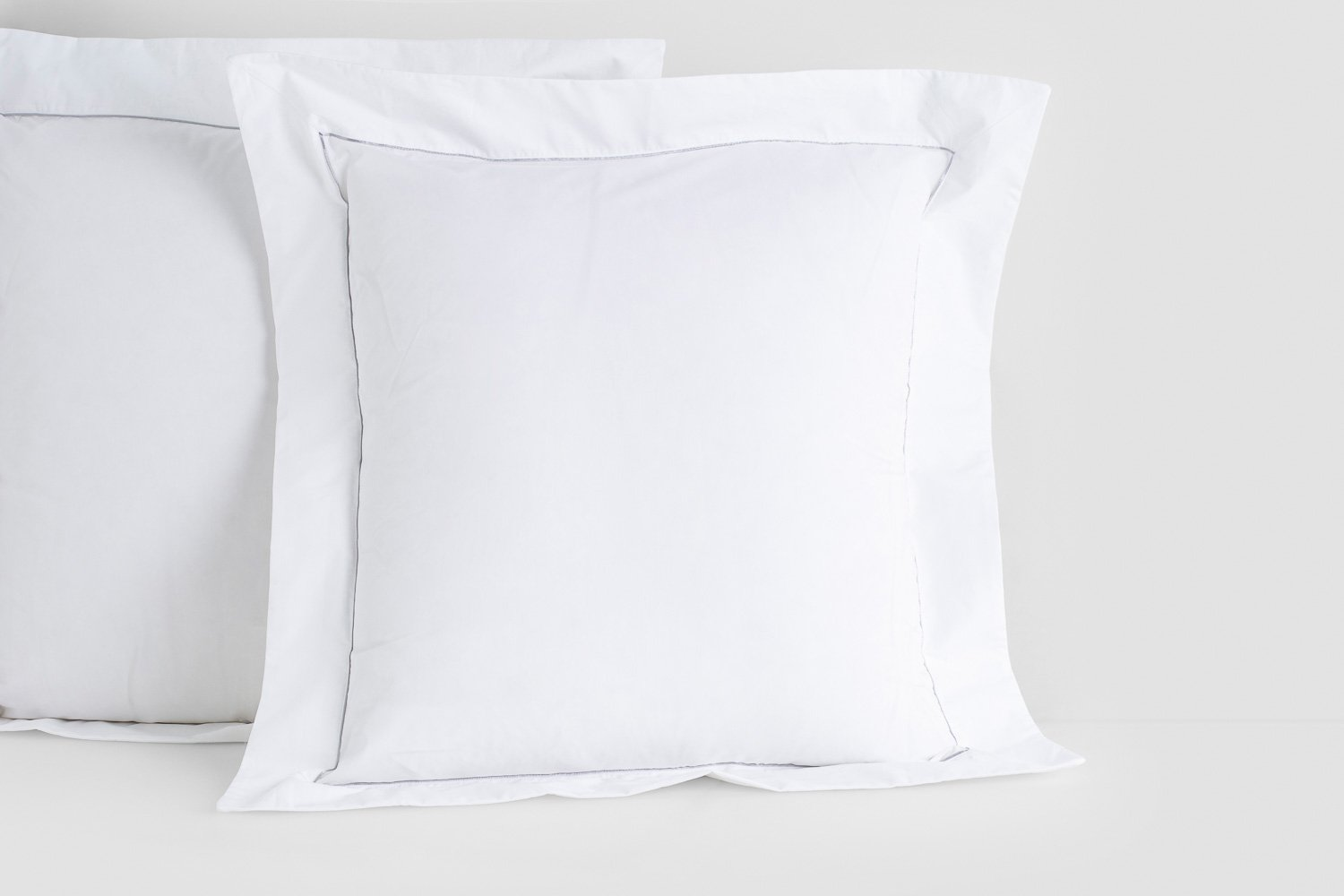 percale euro pillow cases in white with silver piping