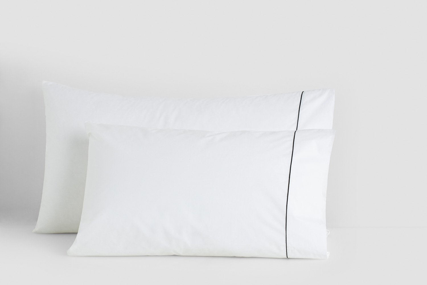 king vs. standard pillow cases in white with black piping